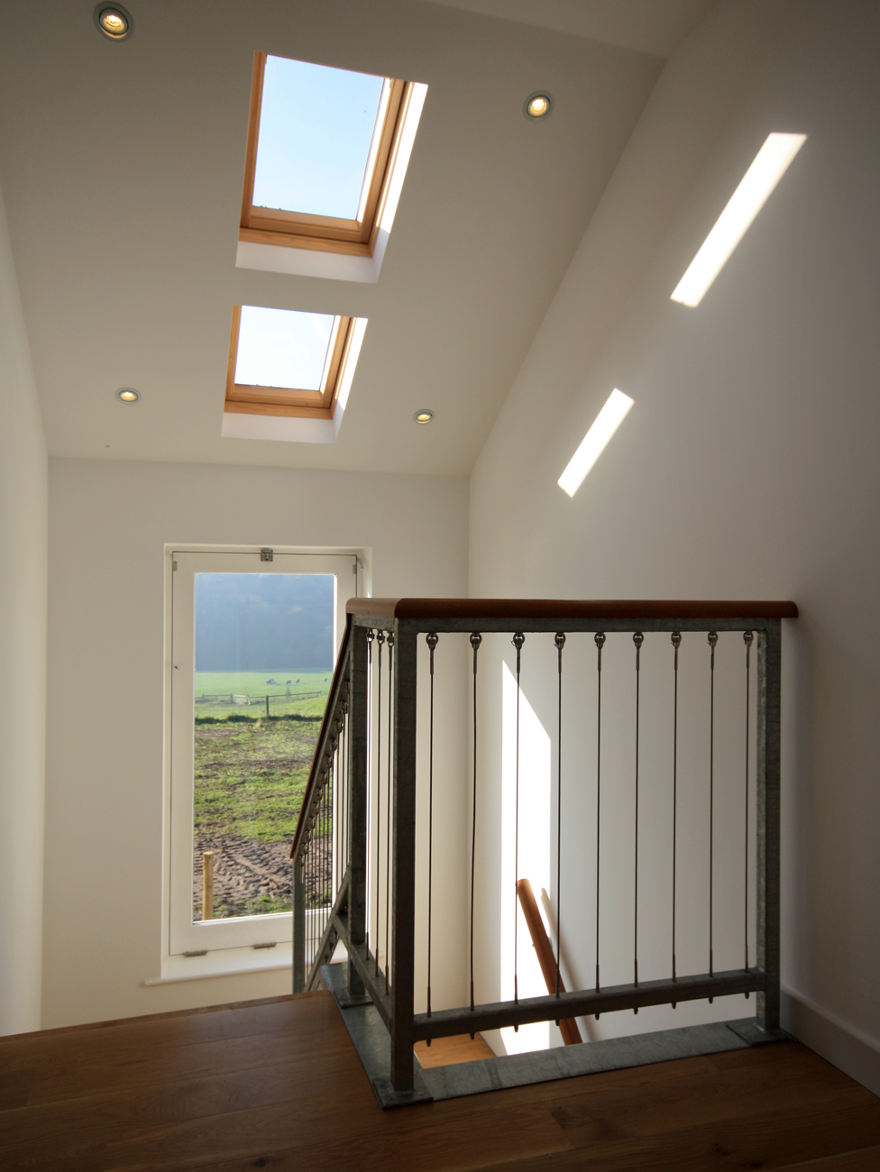 This landing benefits from additional natural light through two roof windows, while the picture-window draws your attention to the countryside view.