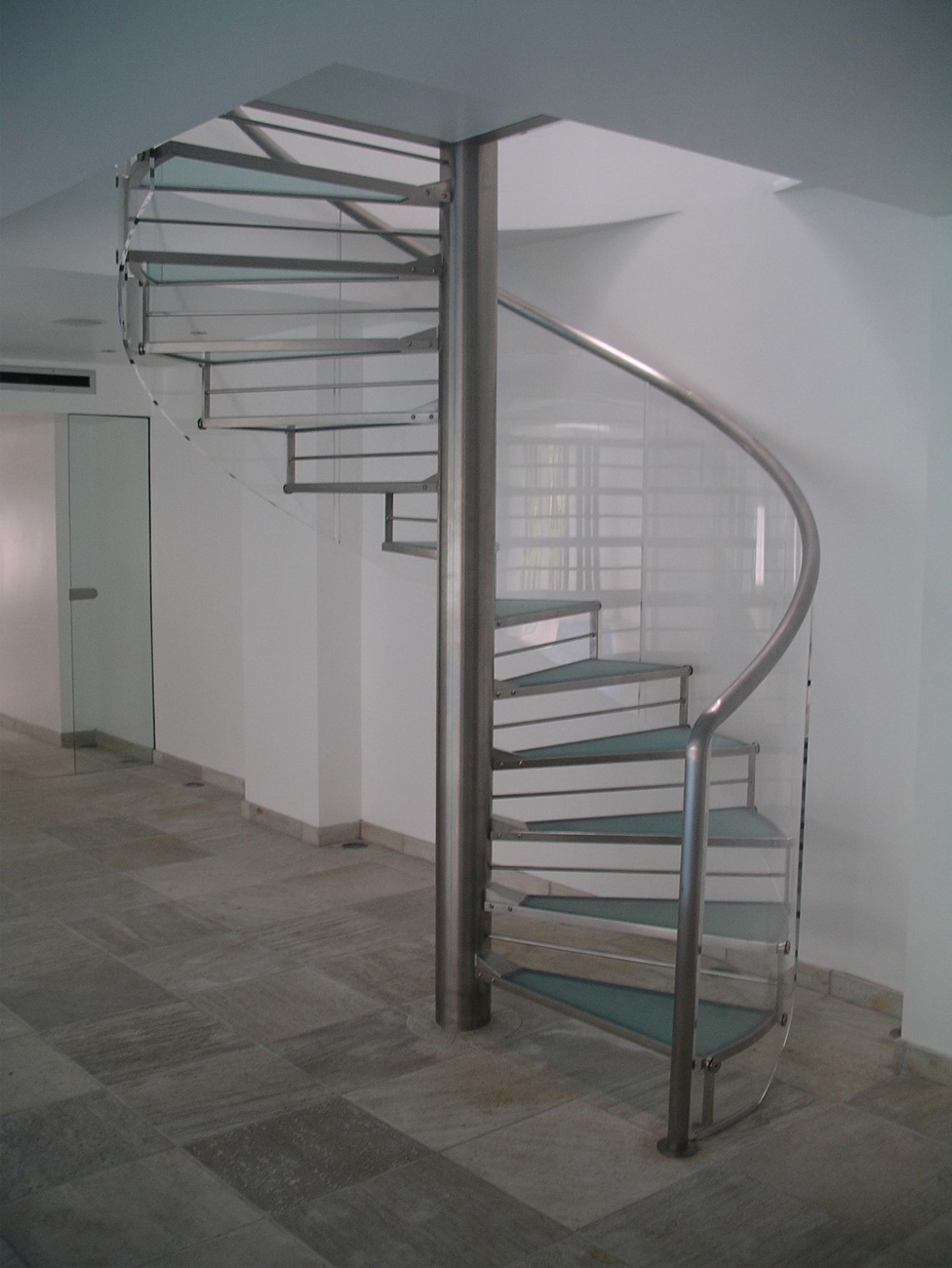 Modern elements may be inserted such as a glazed staircase