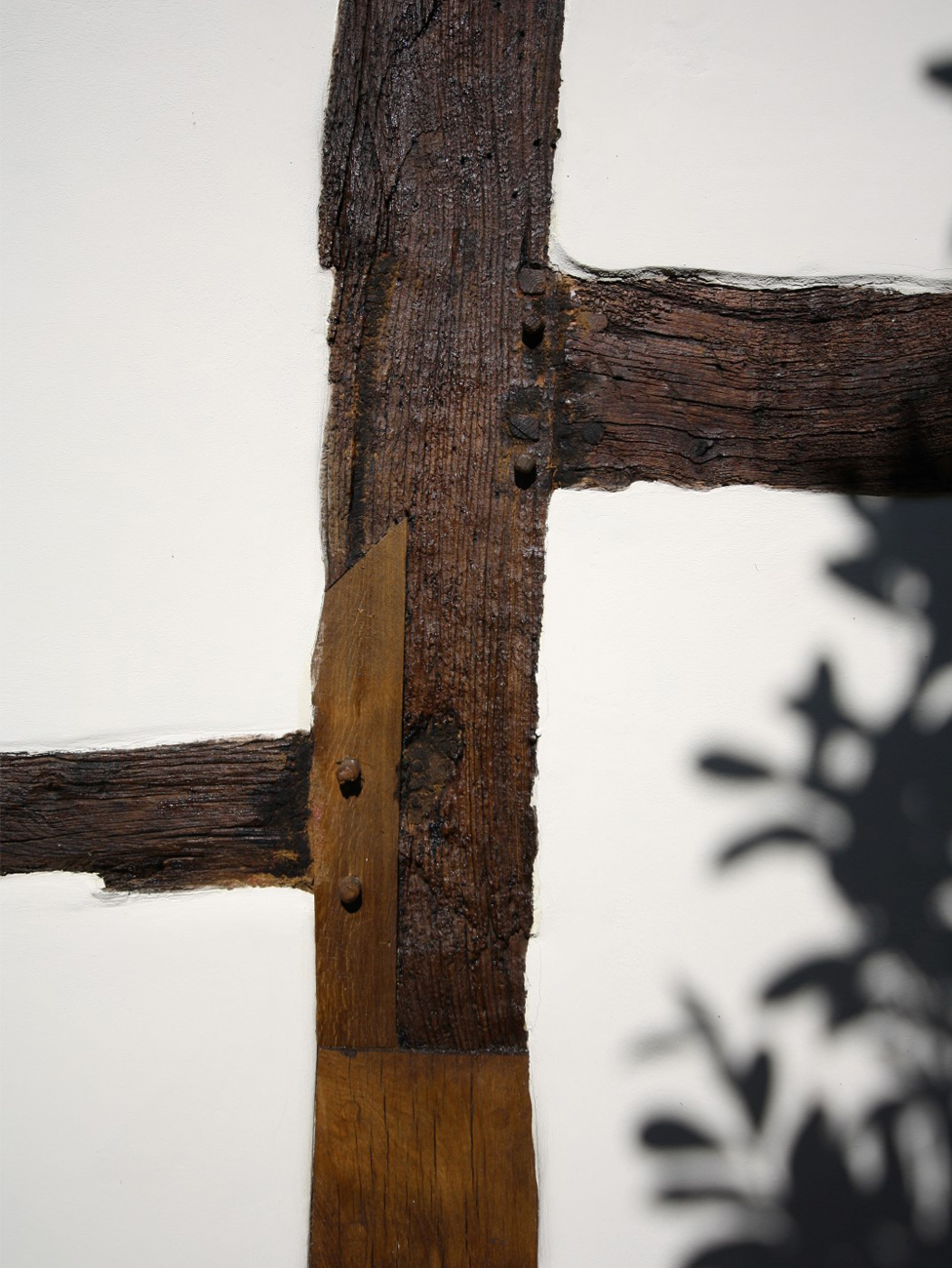 Careful restoration; splicing of old timber with new wood