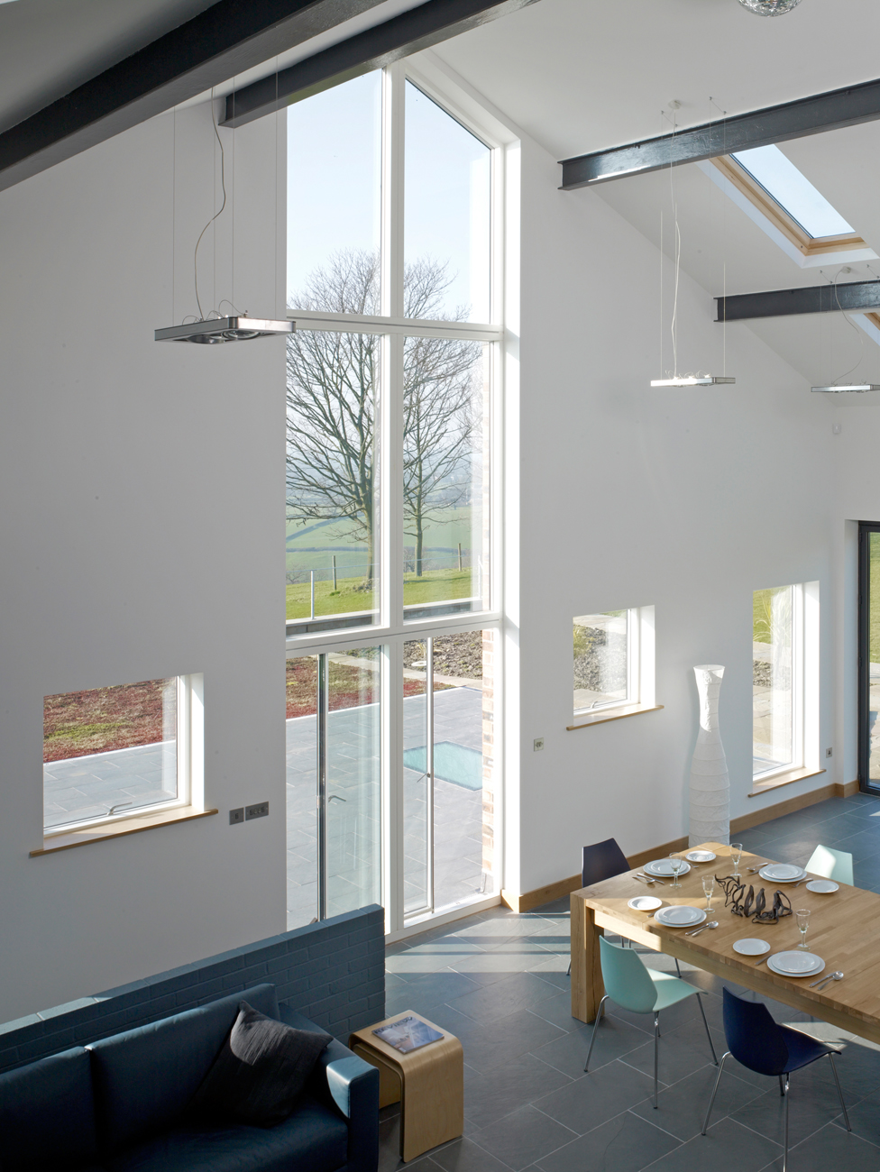A double-height window is used to draw attention to the stunning view of the Cheshire Plain. The space faces north and is flooded with natural light, without the worry of glare or overheating from direct sun.
