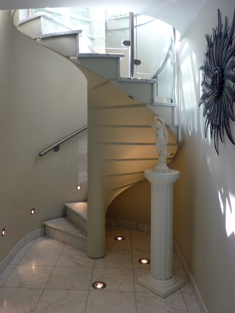 Stone treads with clever lighting to highlight the finer details.